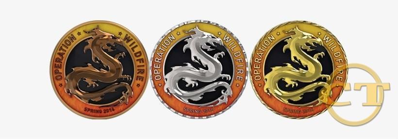 Бронзовая, серебряная и золотая монеты операции Wildfire